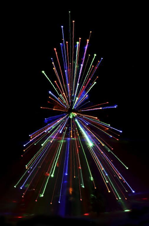 Maker: Jim Taylor  -- 30 points      Judge's comments: Nice colors; very simple; like the bright streak with the starMaker's comments: Starting with small image of tree, rotated zoom lens to telephoto while holding shutter open on BULB.