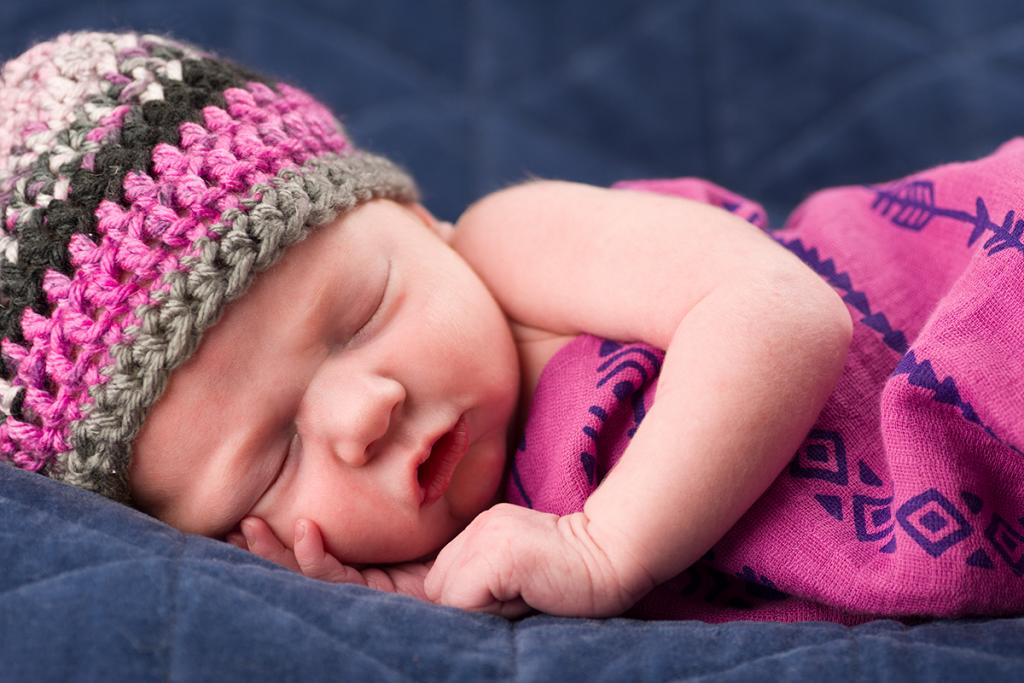 Maker: Brian Barney Entered in: 2017 March Competition - A People Score: 41 points  1st PlaceJudge's comments: Very nice lighting and color; lots of detailMaker's comments: Our new baby Millie. The hardest part of photographing newborns is trying to keep them sleeping wile posing them. Taken with a Nikon D7200 and Tamron 90mm f2.8 macro lens. ISO 200 f4.5 1/160s