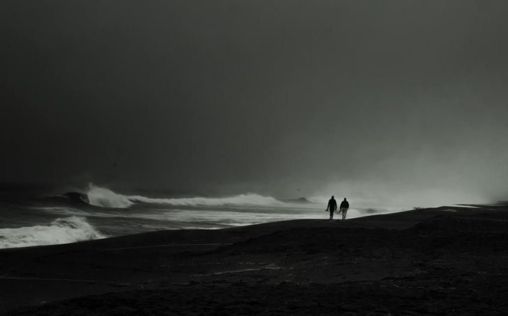 Maker: Kelly Retzlaff… Entered in: 2018 December Competition - A Prints Score: 35 points  1st PlaceJudge's comments: Beautiful lighting on waves. Good matting.Maker's comments: Taken Point Reyes California. I was sitting and watching the waves and this couple walked the shoreline. It was misty and gloomy with a small amount of sunlight coming through the clouds. post process lightroom and silver efex pro 2. canon 70D, Canon 24-70ii.  Kelly Marquardt.