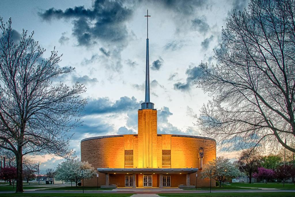 Maker: Kim Ambrose Entered in: 2019 February Competition - A Open Score: 36 points  1st PlaceJudge's comments: Very sharp; beautiful pop of yellow light; trees frame the church; break in the clouds frame the cross; perfectly square & level; perfect time of dayMaker's comments: