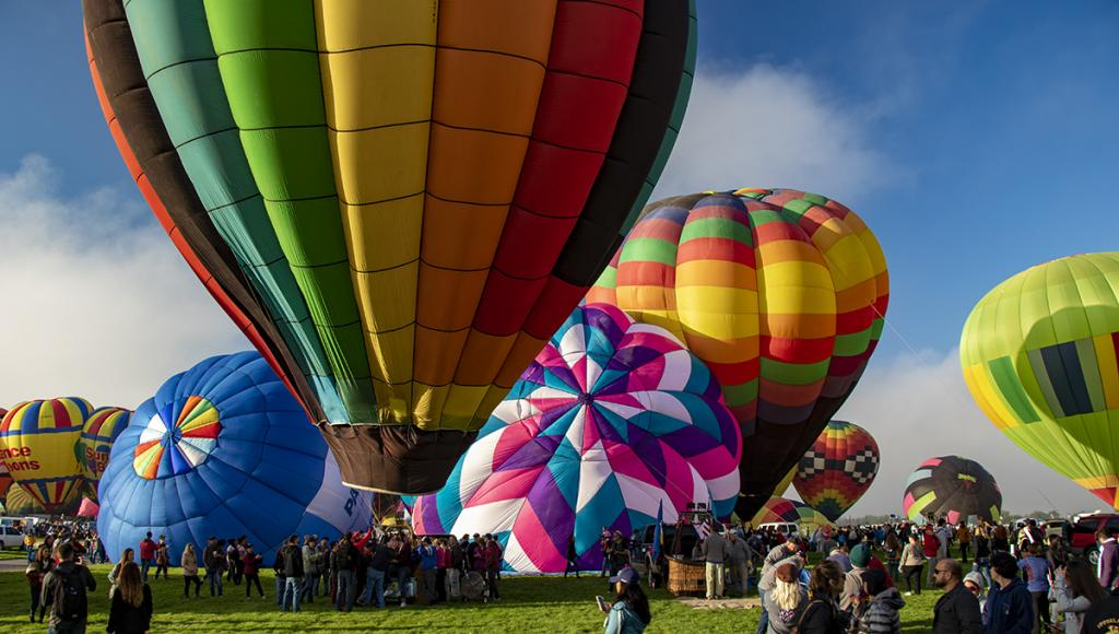 A - Prints Color printsMaker: Brian Narveson  -- 34 points  3rd PlaceJudge's comments: Great color; very sharp; lovely sky; could crop out the yellow balloon on the right to focus on cluster of other balloonsMaker's comments: This image was shot in Albuquerque, New Mexico in Sept 2019 at the Hot Air Balloon Fiesta.  Because lighting was constantly changing I chose to shoot in Auto mode.  Camera picked setting of ISO 100, f/5.6, 1/80 second.  Camera was handheld. Lens set to 18mm.  Image is cropped.