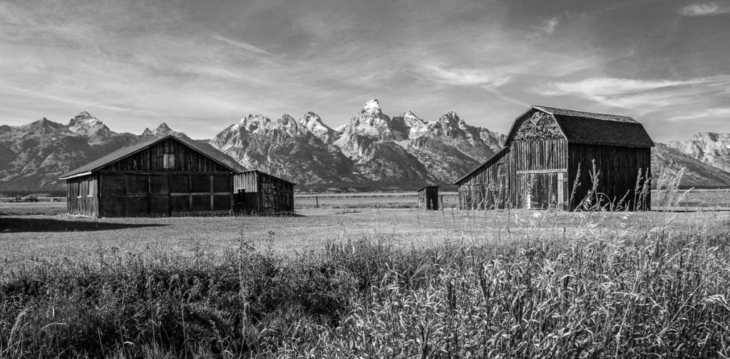 Maker: Austin Miller  -- 34 points      Judge's comments: Works well as a B&W; good detail; beautiful sky; sharp from front to back; buildings frame the peak in the background; could also be two imagesMaker's comments: