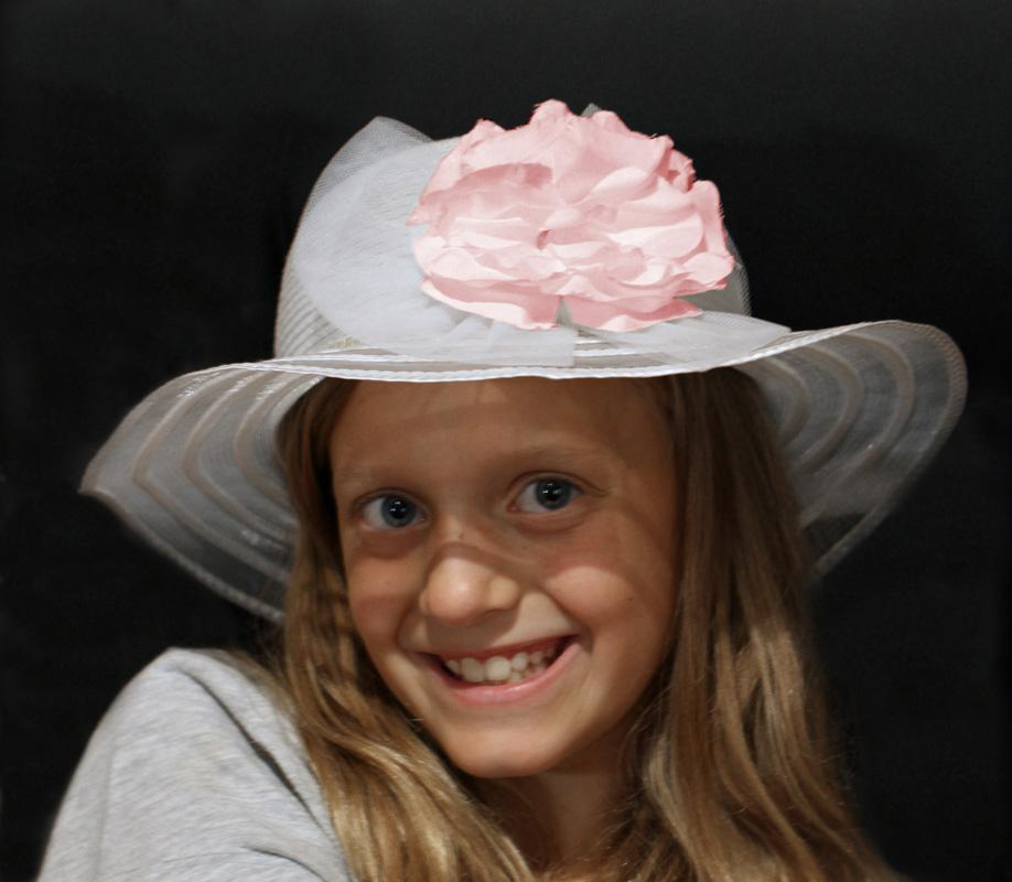 Maker: Sonja Haske  -- 28 points      Judge's comments: Very cute image; very nice pose and expression; hat frames the face nicely; the light source is fairly bright on the hat and creates a shadow across the faceMaker's comments: