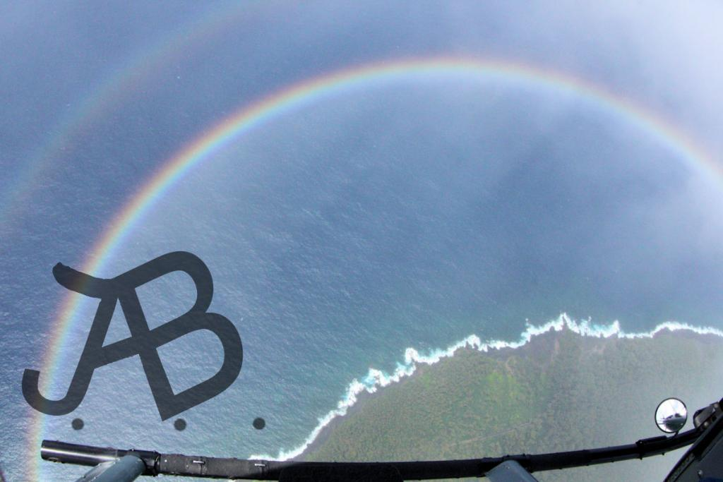 Maker: Jerry Bonsack  -- 30 points  Voted Acc.Judge's comments: Very unusual image; sharp; great perspective; could clone out mirror in lower rightMaker's comments: South shore of Hawaii, while flying through a short rain storm, with broken clouds.